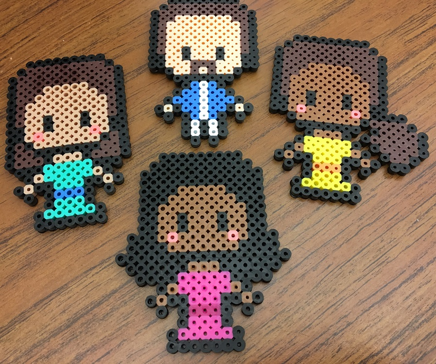 Angelica, Eliza, Peggy, and Hamilton in their pixel art forms