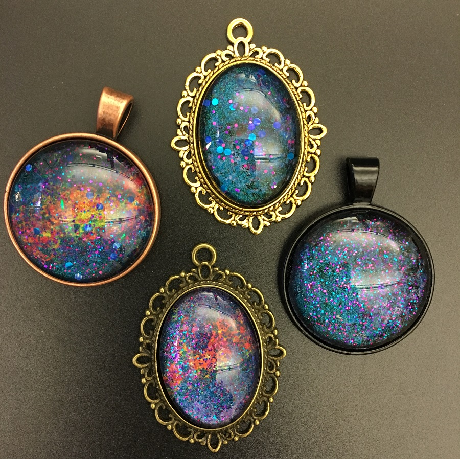 Four examples of galaxy pendants