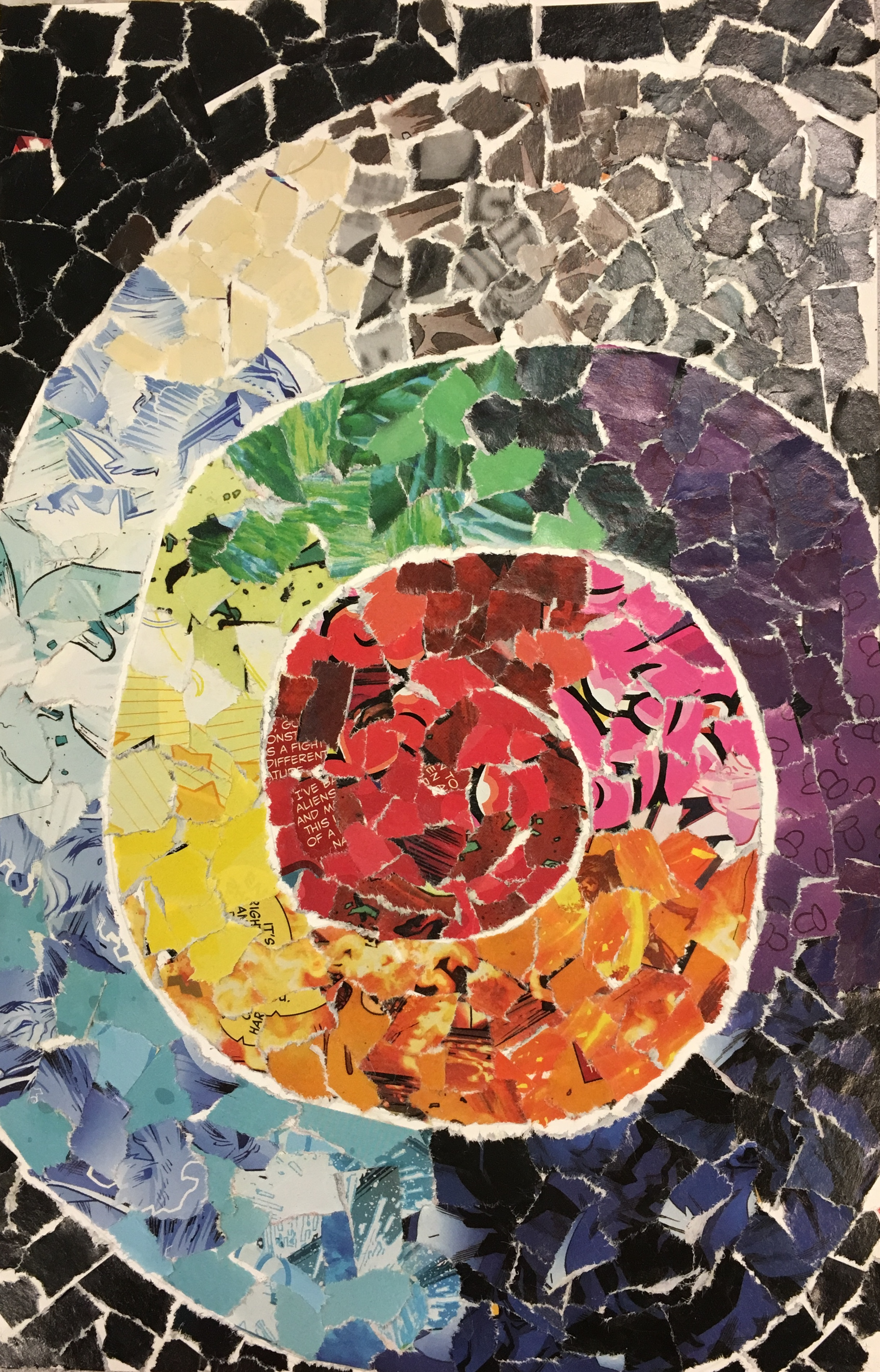 a colorful mosaic art spiral made of small pieces of magazine pages
