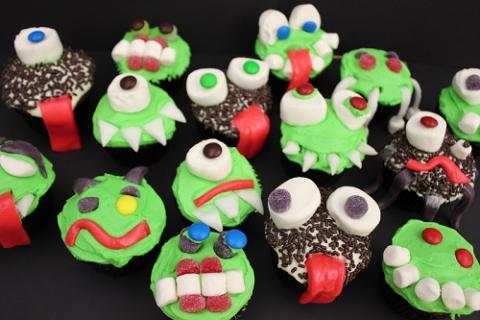 Examples of Creepcakes with green frosting, marshmallow eyes, and airhead tongues