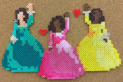 Schuyler Sisters-Work pose made out of perler beads (on bulletin board)